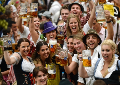 Visitors wearing traditional Bavarian clothes raise their beers in a festival tent at the start of the Oktoberfest beer festival at the Theresienwiese in Munich, southern Germany. This year's edition of the world's biggest beer festival Oktoberfest will run until October 7, 2012. AFP PHOTO / CHRISTOF STACHE (Photo credit should read CHRISTOF STACHE/AFP/GettyImages)